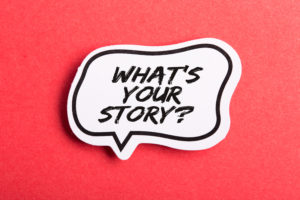 What Is Your Story speech bubble isolated on the red background.